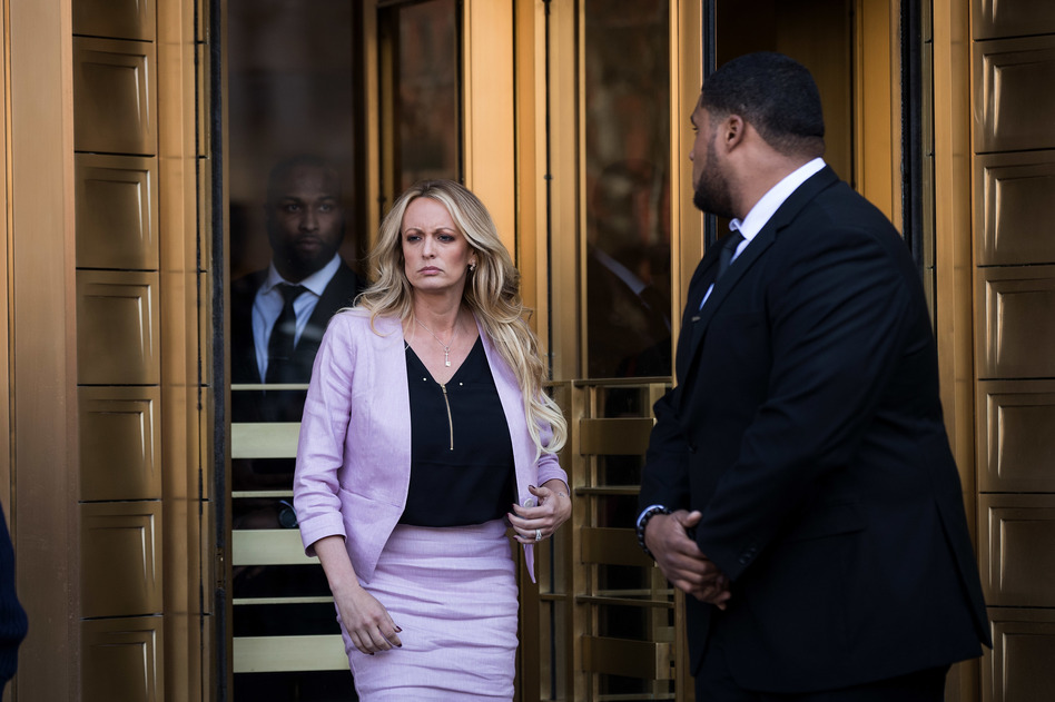 Adult film actress Stormy Daniels speaks to reporters as she exits a federal courthouse in New York City after a hearing related to Michael Cohen, President Trump's longtime personal attorney and confidante on April 16.
