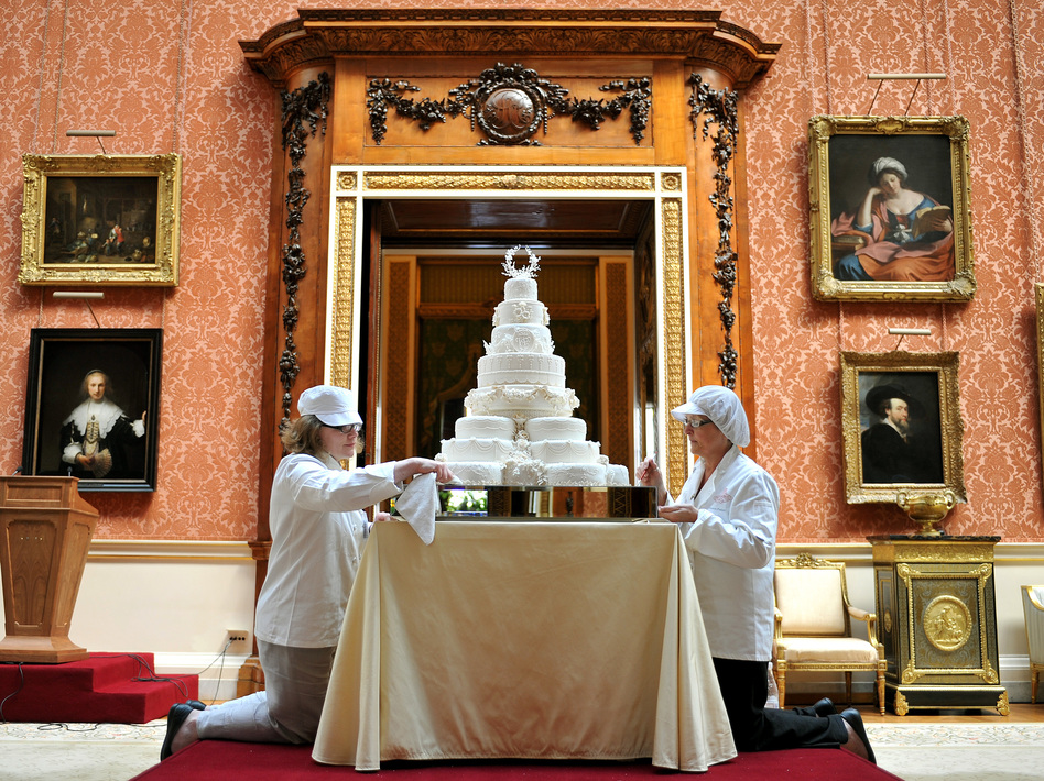 A slice of cake from the 2011 wedding of Prince William and Kate Middleton will be sold by Julien's Auctions in June. Pieces of four other royal wedding cakes also will be auctioned off. (John Stillwell/AP)