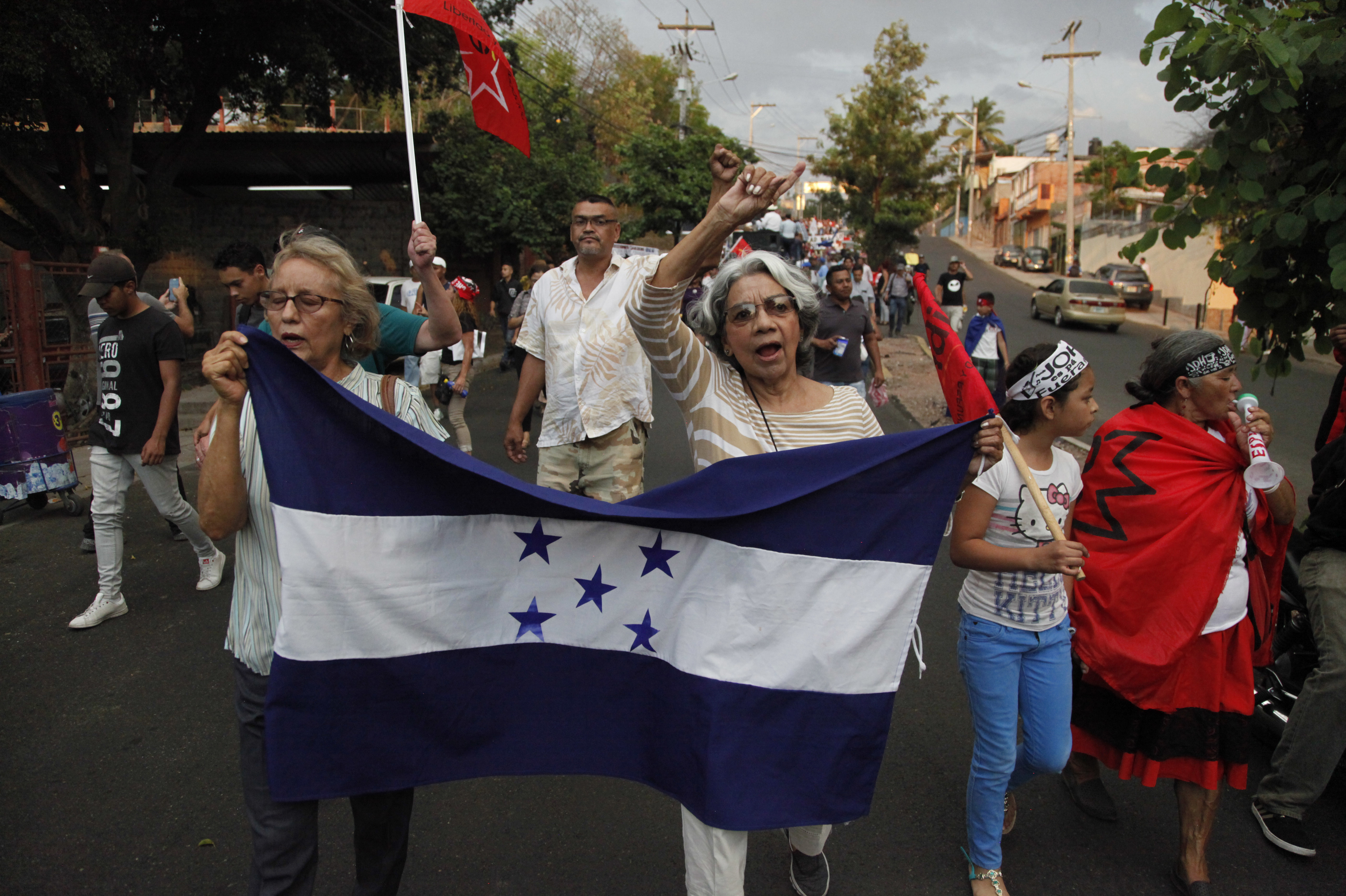 """Members of the opposition to the administration of Honduran President Juan Orlando Hernandez march on Friday to protest the U.S. government's decision to end the Temporary Protected Status designation for nearly 57,000 people from Honduras. Hernandez called the decision a sovereign issue for Washington, adding that """"we deeply lament it."""""""