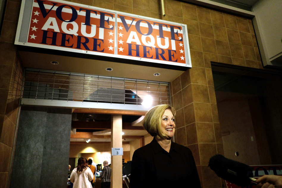 Travis County Clerk Dana Debeauvoir speaks to the media at the Early Voting Mega Center at Austin in October 2016. Debeauvoir has spent a decade trying to create a more secure electronic touchscreen voting system. (Jorge Sanhueza-Lyon/KUT News)