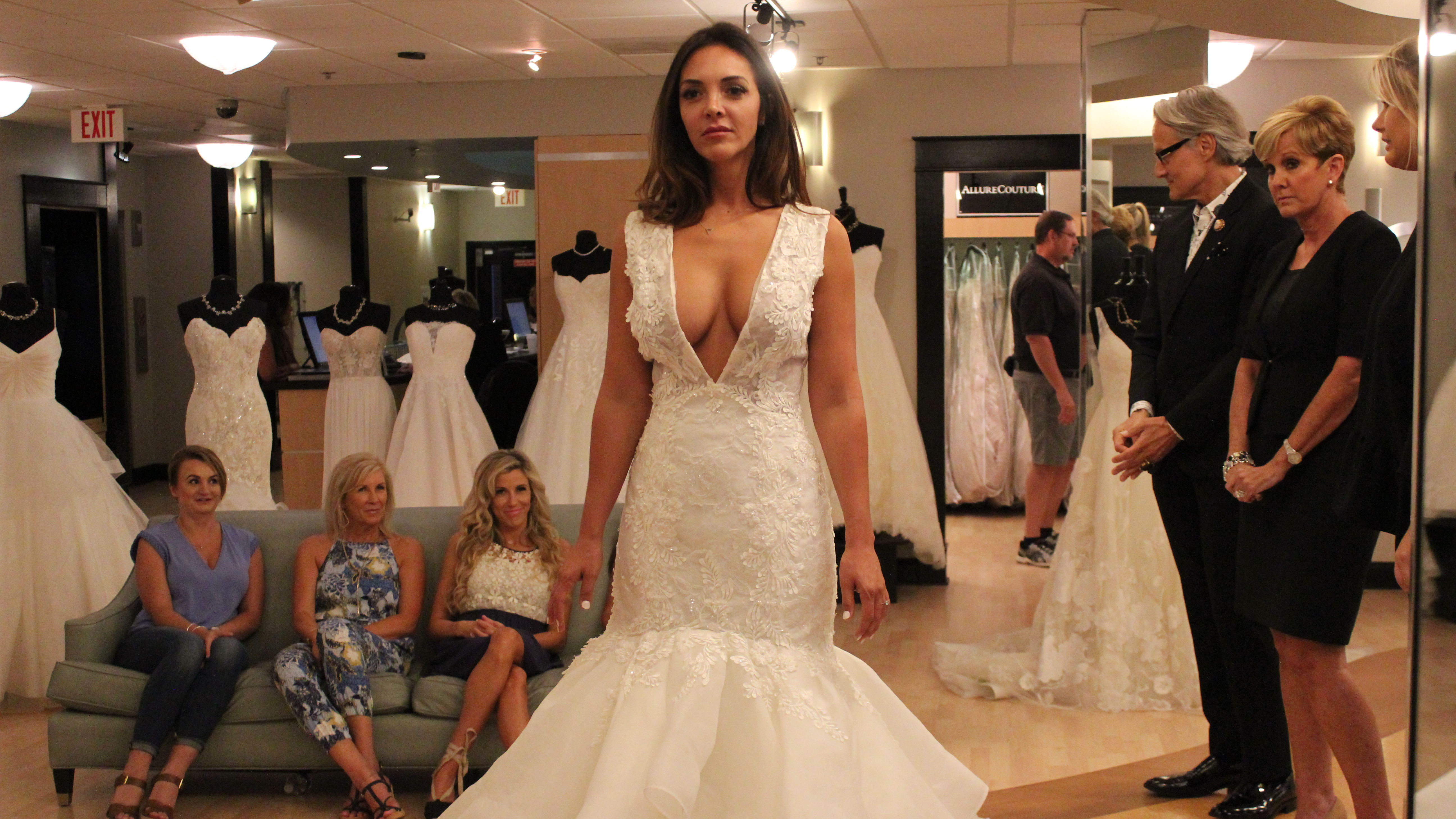 Bride Lindsey Morgan tries on a popular style on an episode of TLC's Say  Yes to the Dress Atlanta. Host Monte Durham stands second from right.
