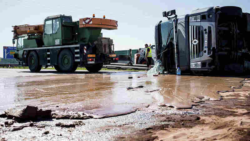Sugar Crash: After Tanker Flips, Chocolate Bars Traffic On Polish Highway