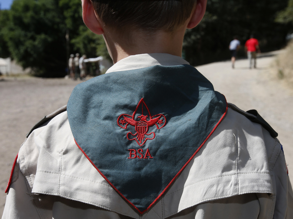 The Mormon church says it will end its relationship with the Boy Scouts of America and will create a youth development program of its own. (George Frey/Getty Images)
