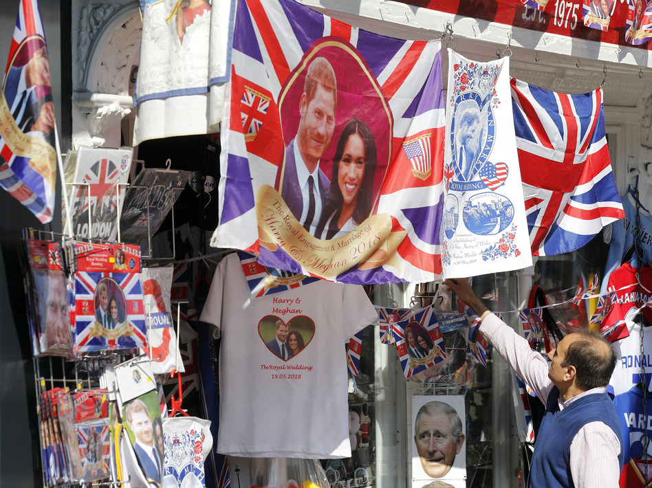 A souvenir shop in Windsor, England, sells wedding-themed T-shirts and other memorabilia ahead of Saturday's royal wedding. (Frank Augstein/AP)