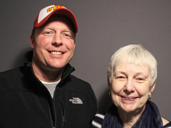 At StoryCorps in Des Moines, Iowa, in April, Ginnie Peters, 63, (at right) poses with Trent Andrews, 43, who took over farming her family's land in 2011 after her husband, Matt, took his own life.