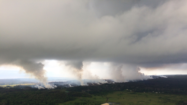An image provided by the U.S. Geological Survey shows sulfur dioxide plumes rising from Kilauea