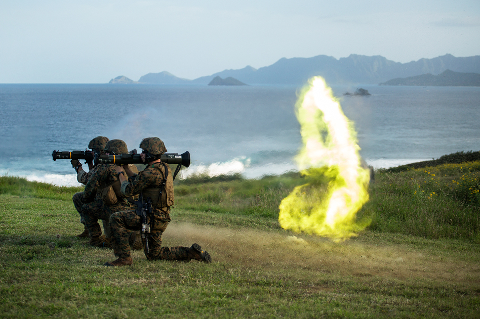 Marines based in Okinawa, Japan, fire an M136 AT-4 rocket launcher as part of a weapons training exercise on the Kaneohe Bay Range Training Facility, in 2014. (Lance Cpl. Matthew Bragg/U.S. Marines/DVIDS)