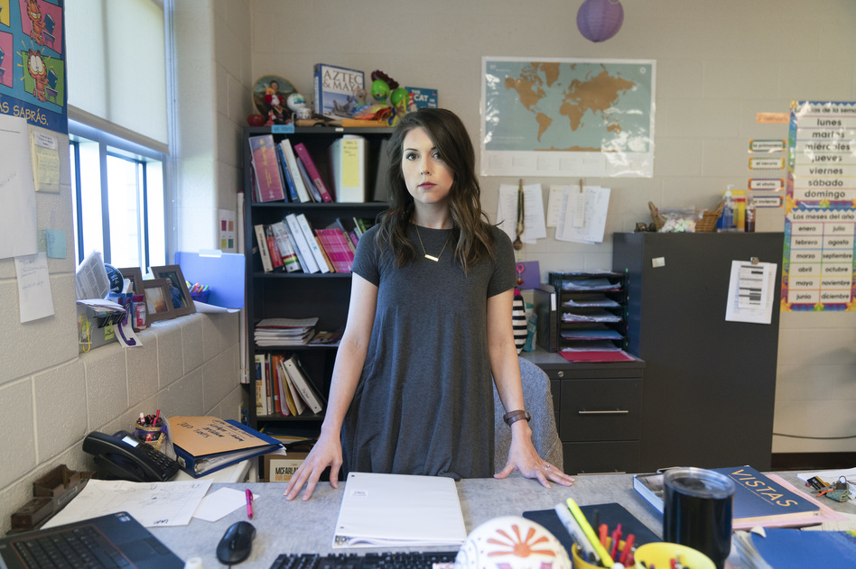 """Kaitlyn McCollum teaches at Columbia Central High School in Tennessee. After being told her TEACH grant paperwork was late, her grants were converted to loans. """"I'm on the phone in between classes ... trying to get all of this information together, crying, trying to plead my case,"""" she says. (Stacy Kranitz for NPR)"""