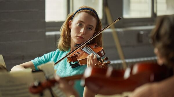 Saoirse Ronan plays newlywed Florence in On Chesil Beach, in theaters now.