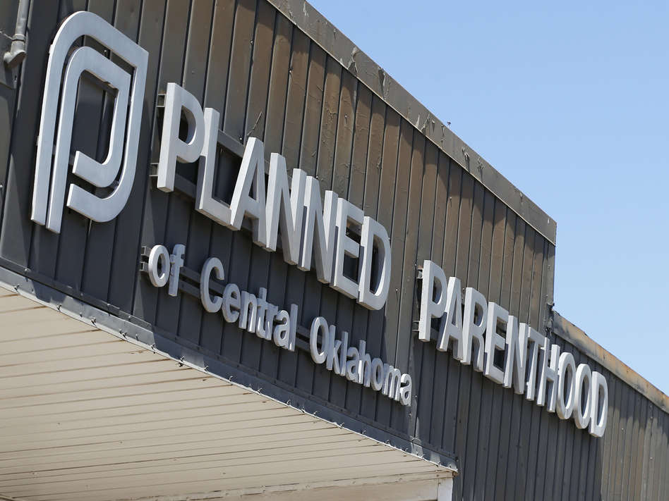 "In a statement from the Planned Parenthood Federation of America on the rule, the group said it would not ""stand by while our basic health rights are stripped away."" (Sue Ogrocki/AP)"