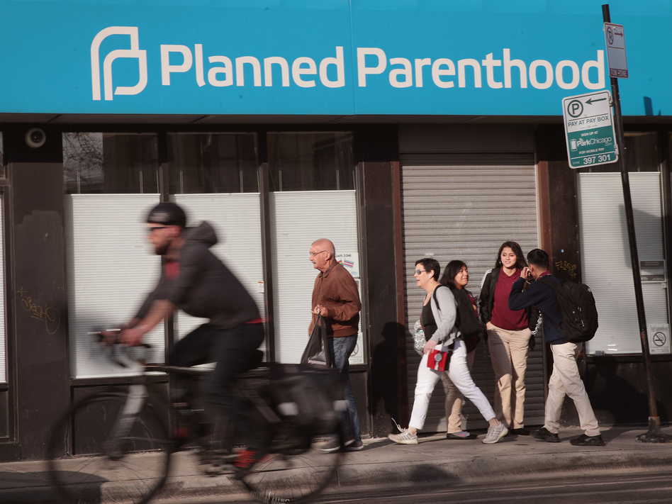 Planned Parenthood's affiliated clinics, like this one in Chicago, provide wellness exams and comprehensive contraceptive services, as well as screenings for cancer and sexually transmitted diseases for both women and men. (Scott Olson/Getty Images)