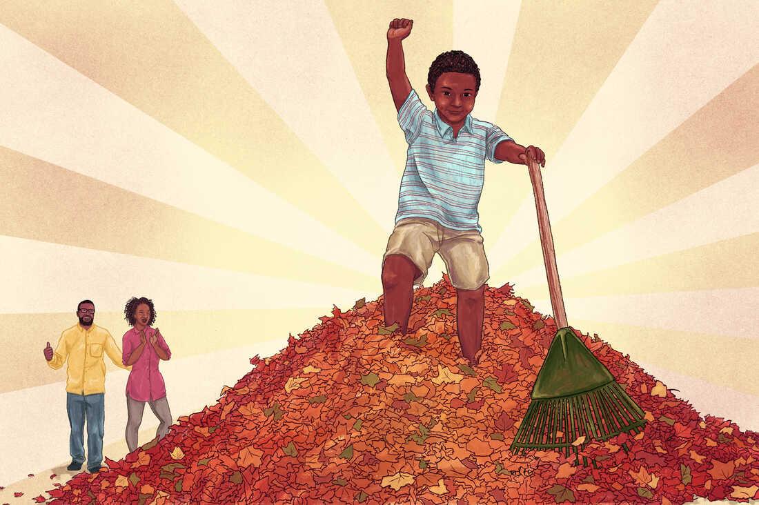 Boy completes his chore of raking leaves