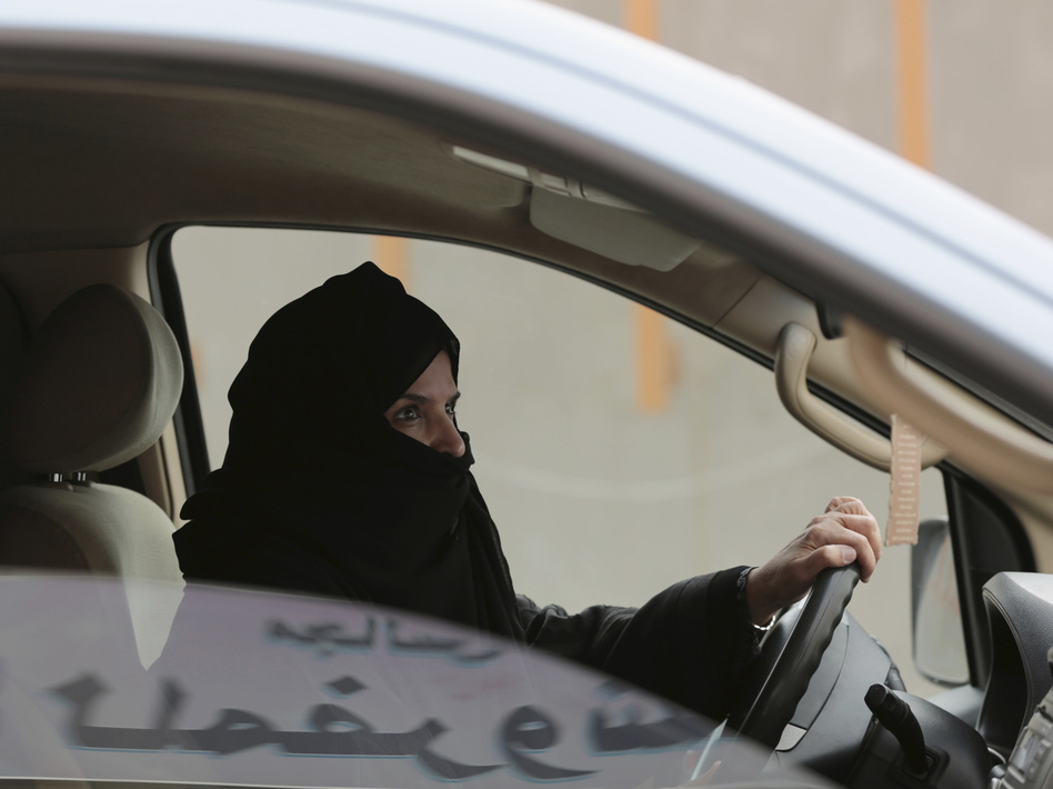 Saudi activist Aziza al-Yousef was arrested this week, along with other women's activists. In this March 29, 2014 photo, she drives a car on a highway in Riyadh as part of a campaign to defy Saudi Arabia's ban on women driving. (Hasan Jamali/AP)