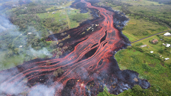 In this photo taken Saturday and released by the U.S. Geological Survey, lava flows from fissures near Pahoa, Hawaii.