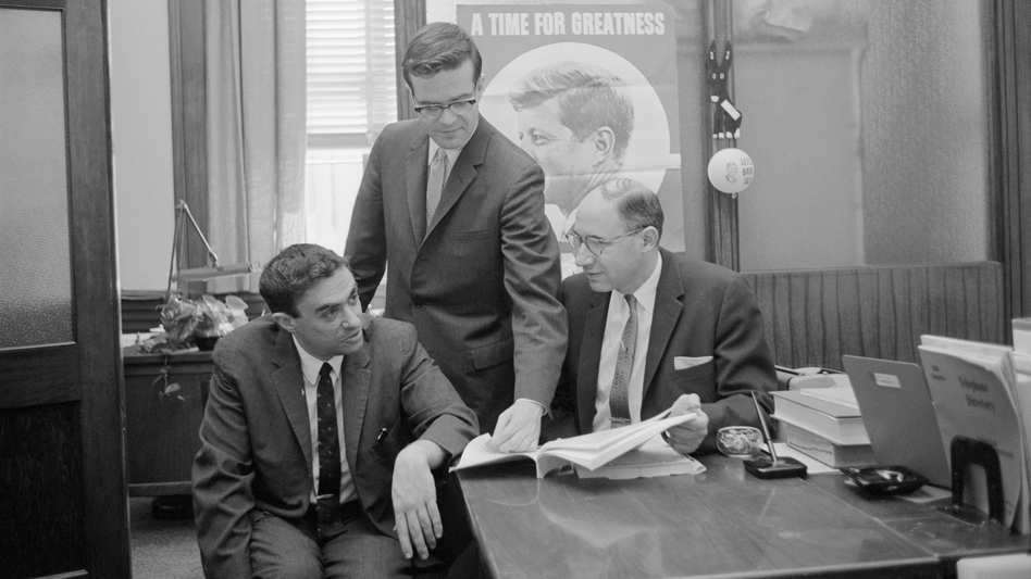 Richard Goodwin (left) worked for John F. Kennedy, first on his presidential campaign and then in the White House. He also wrote influential speeches for President Lyndon Johnson. Goodwin is seen here with Ted Sorensen (center) and Myer Feldman. (Bettmann Archive)