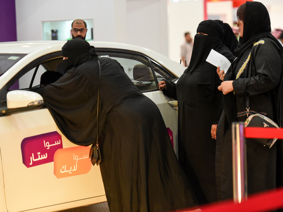 Saudi women check out cars at an automotive exhibition for women in the Saudi capital Riyadh on May 13. (Fayez Nureldine/AFP/Getty Images)