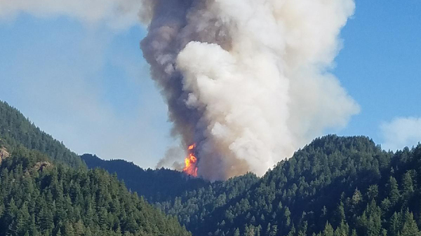 The Eagle Creek wildfire burns in the Columbia River Gorge east of Portland, Ore., in September. The teenager who threw the firework that started the fire has been ordered to pay $36.6 million to victims who suffered damages.