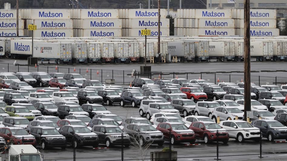 New cars and cargo containers are shown in a staging area, on April 6, 2018, at the Port of Tacoma in Wash. On Wednesday, President Donald Trump ordered the Commerce secretary to look into whether tariffs are needed on vehicles and auto parts imported to the U.S. (Ted S. Warren/AP)