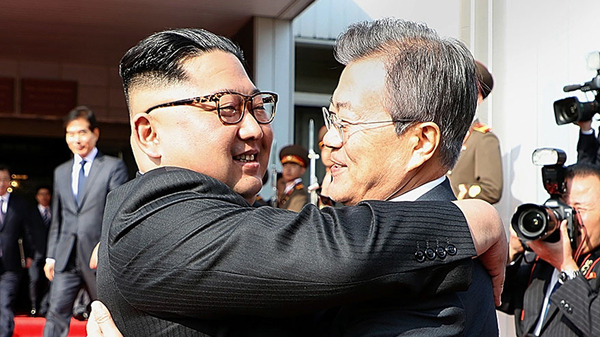 In this handout image provided by South Korean Presidential Blue House, South Korean President Moon Jae-in (Right) hugs with North Korean leader Kim Jong Un (Left) before their meeting on Saturday.