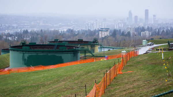 Canada is buying a pipeline expansion project rather than risk it being derailed by protests and delays. Here, oil tanks stand near the Trans Mountain pipeline expansion site in Burnaby, British Columbia, in April.