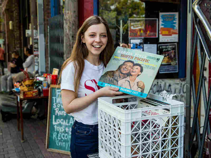Jade Bird shuffles through a record bin in Deep Ellum, Dallas.