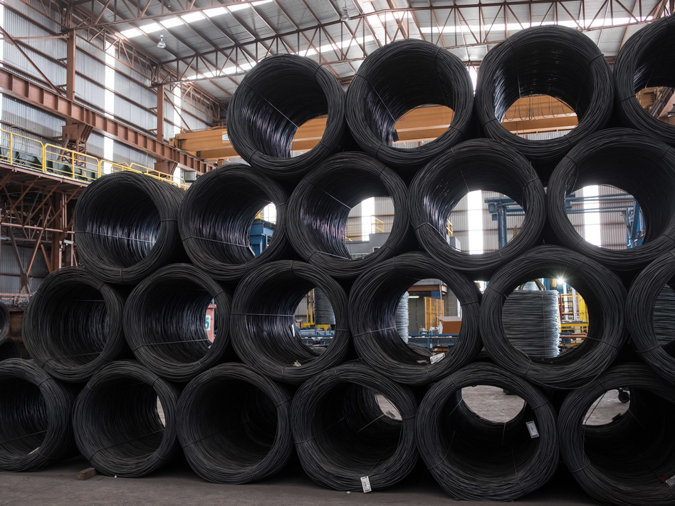Coils of steel wire sit stacked in the shipping area of the Grupo Acerero SA steel processing facility in San Luis Potosi, Mexico, in March. Mexican steel will be subject to a 25 percent tariff. (Mauricio Palos/Bloomberg via Getty Images)