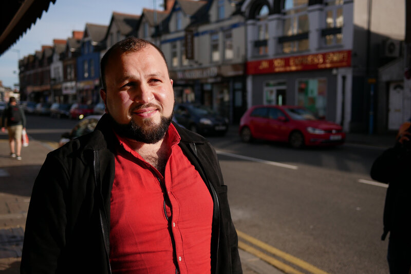 Hussam Allahham, a refugee from Syria who is trained as a doctor, now works part-time for a refugee aid organization in Wales. He says Syrians can be shocked when they reach small villages, and he tells them to consider it a break after years of struggle to survive.