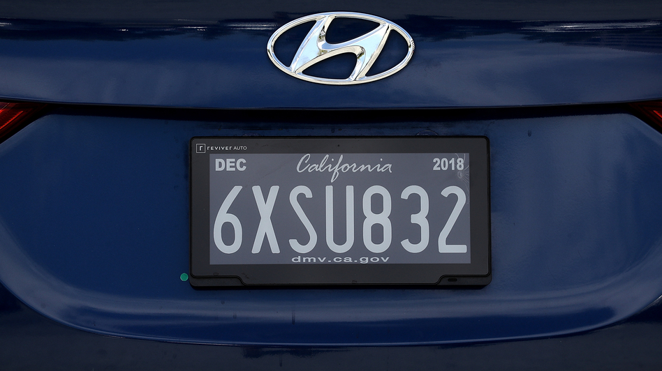 A digital license plate made by Bay Area company Reviver Auto is displayed at the company's headquarters on May 30 in Foster City, Calif. The plates have the ability to track cars and play ads.