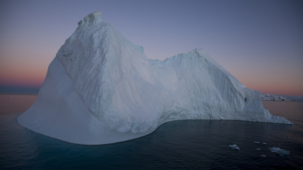 Icebergs mark the approach to the Antarctic Peninsula. Trying to catch the predawn light means being on deck well before the 3:15 a.m. sunrise, when subtler hues bathe the ice forms.