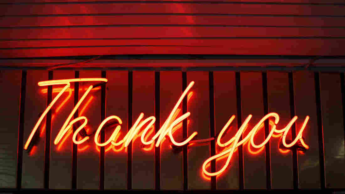 """A """"Thank you"""" sign in glowing neon."""