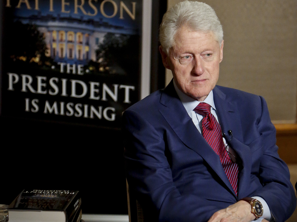 Former President Bill Clinton listens during a Monday interview about <em>The President is Missing</em>, a novel he wrote with James Patterson. (Bebeto Matthews/AP)