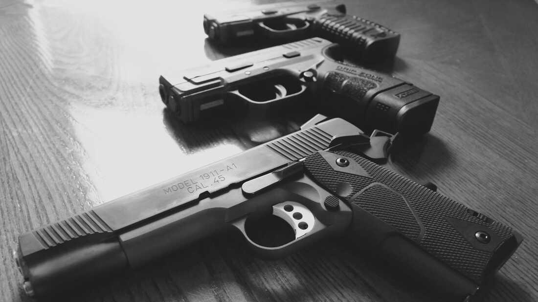 Three handguns.