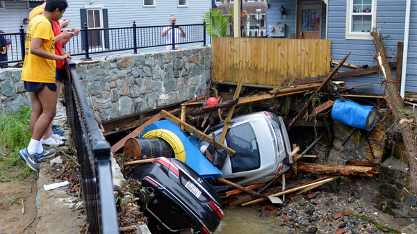 Debris and cars clog the Patapsco River in Ellicott City, Md., after flooding on May 27 that killed one person and destroyed much of the town