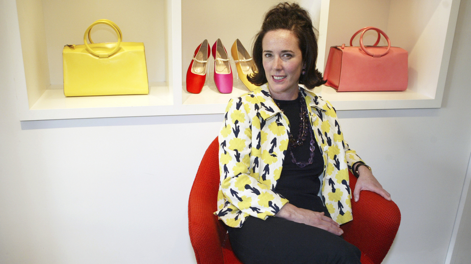 Designer Kate Spade is seen in 2004 among handbags and shoes from her collection. Spade was found dead in her New York City apartment on Tuesday. She was 55. (Bebeto Matthews/AP)