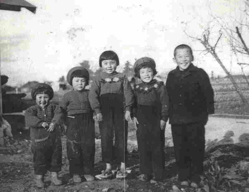 Smiling with neighbors' children on her grandparents' farm Hirono is second from the right, next to her brother Roy on the far right.