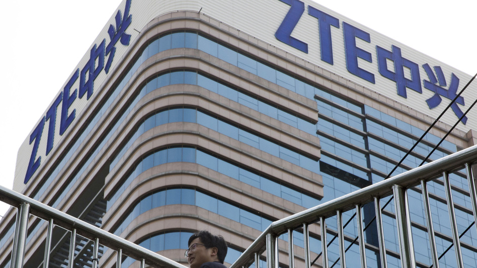 A man walks past a building with the ZTE logos in Beijing in a photo taken last month. (Ng Han Guan/AP)