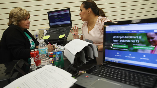 Margarita Mills (left), an insurance agent from Sunshine Life and Health Advisors, speaks with Daniela Morales as she shops for insurance under the Affordable Care Act at a store setup in the Mall of Americas on November 1, 2017, in Miami, Fla.