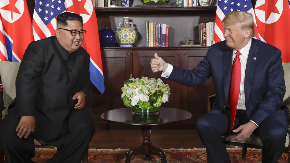 President Trump gives North Korea leader Kim Jong Un a thumbs up at their meeting at the Capella resort on Sentosa Island in Singapore on Tuesday.