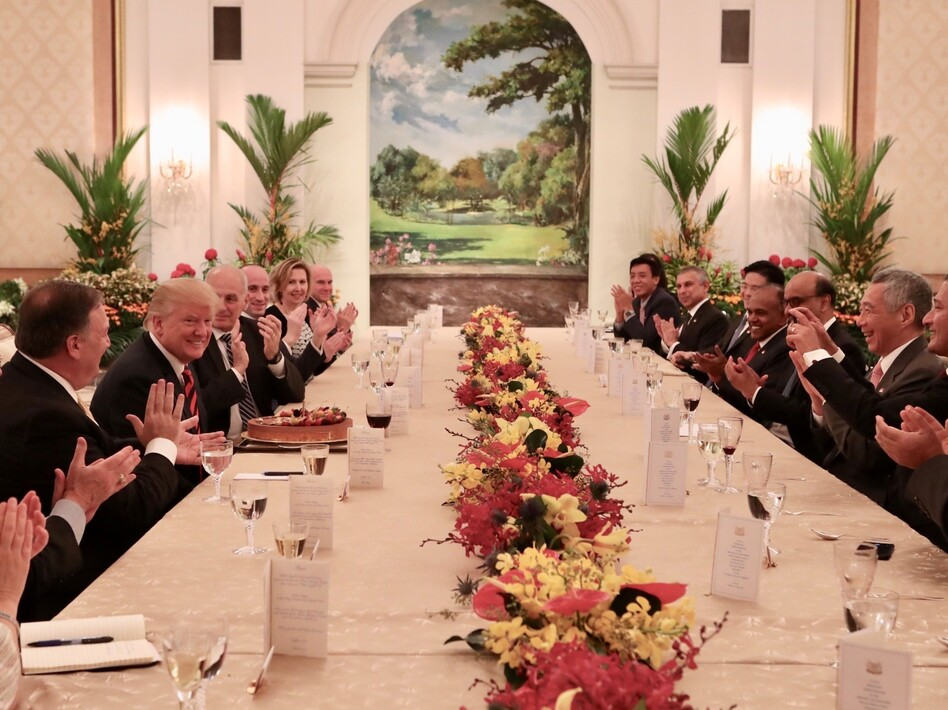 President Trump participates in a working luncheon hosted by Singapore's Prime Minister Lee Hsien Loong in Singapore on Monday. Officials from both delegations also attended the luncheon. (Photo by Ministry of Communications and Information, Republic of Singapore / Handout/Anadolu Agency/Getty Images)