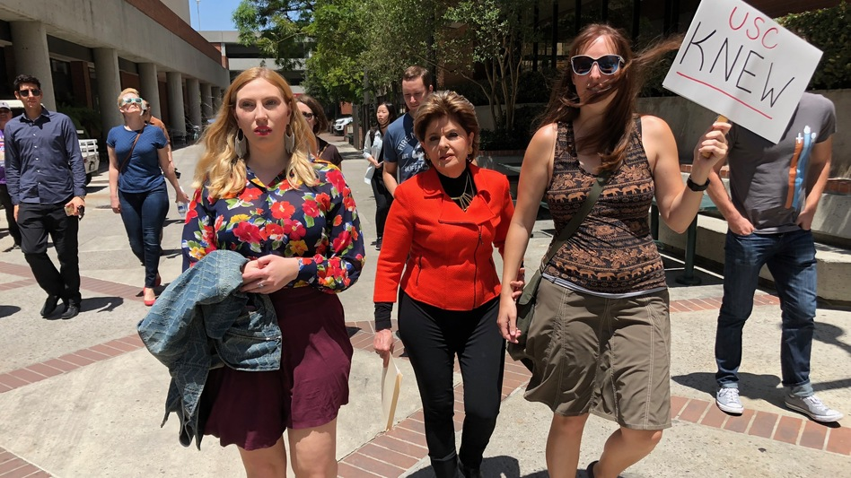 Attorney Gloria Allred, center, marched with students and alumni at USC on Saturday. (Saul Gonzalez/KCRW)