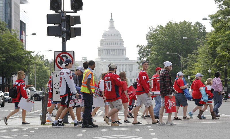 fdfc732502e Enlarge this image. Washington Capitals fans cross Pennsylvania Avenue as  they head toward the Stanley Cup victory parade route on the ...