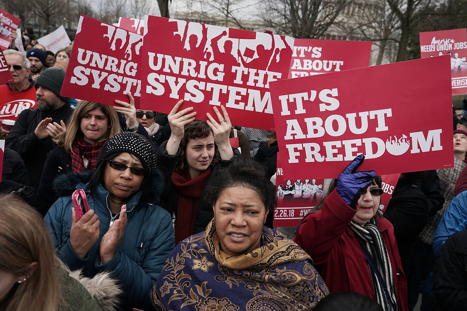 Activists rally in front of the U.S. Supreme Court on Feb. 26. (Alex Wong/Getty Images)