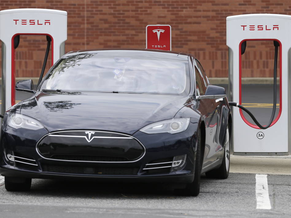 A Tesla car recharges at a shopping center in North Carolina in 2017.