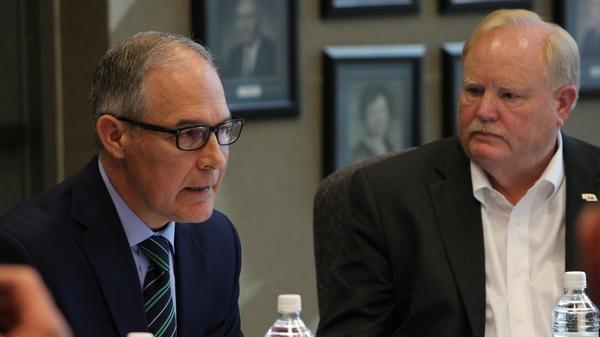 Steve Nelson (right), president of the Nebraska Farm Bureau, looks on as Scott Pruitt talks to farmers in Reliance, S.D.