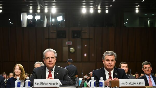 Justice Department Inspector General Michael Horowitz and FBI Director Christopher Wray wait to testify before the Senate Judiciary Committee on Monday.