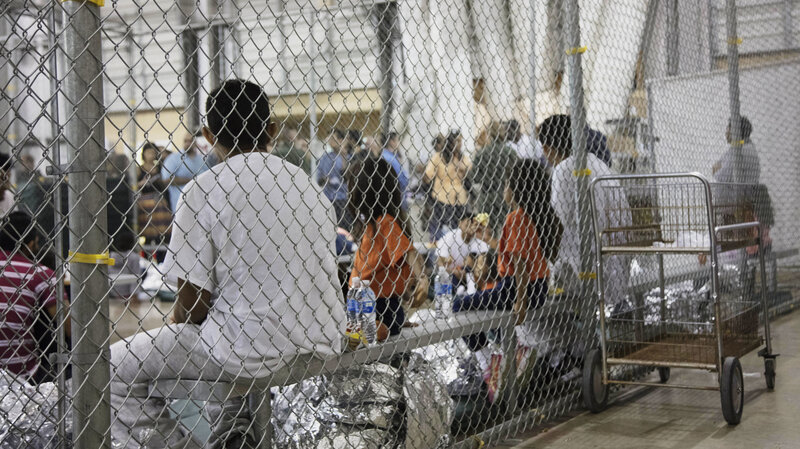 A photo provided by U.S. Customs and Border Protection shows people detained at a facility in McAllen, Texas, on Sunday. (U.S. Customs and Border Protection's Rio Grande Valley Sector via AP)