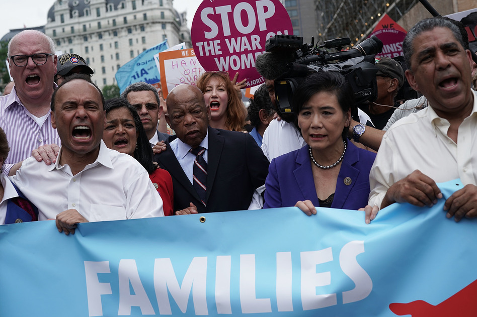 Democratic members of Congress protest the Trump family separate policy. From left to right: Reps. Joseph Crowley, Luis Gutierrez, Pramila Jayapal, John Lewis and Judy Chu. (Alex Wong/Getty Images)