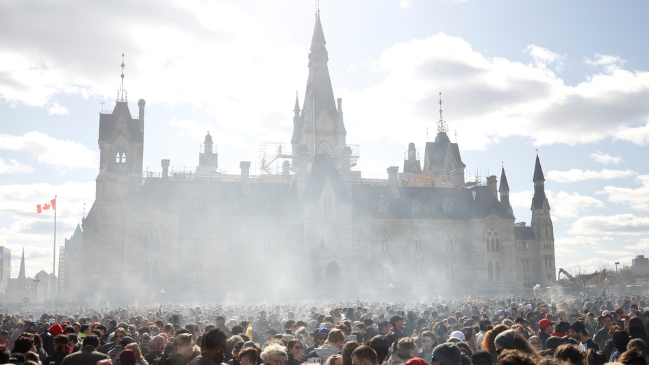 Canada's House of Commons voted to legalize recreational marijuana use, sending the bill to the Senate. In this photo from April 20, smoke rises during the annual 4/20 marijuana rally on Parliament Hill in Ottawa, Ontario. (Chris Wattie/Reuters)