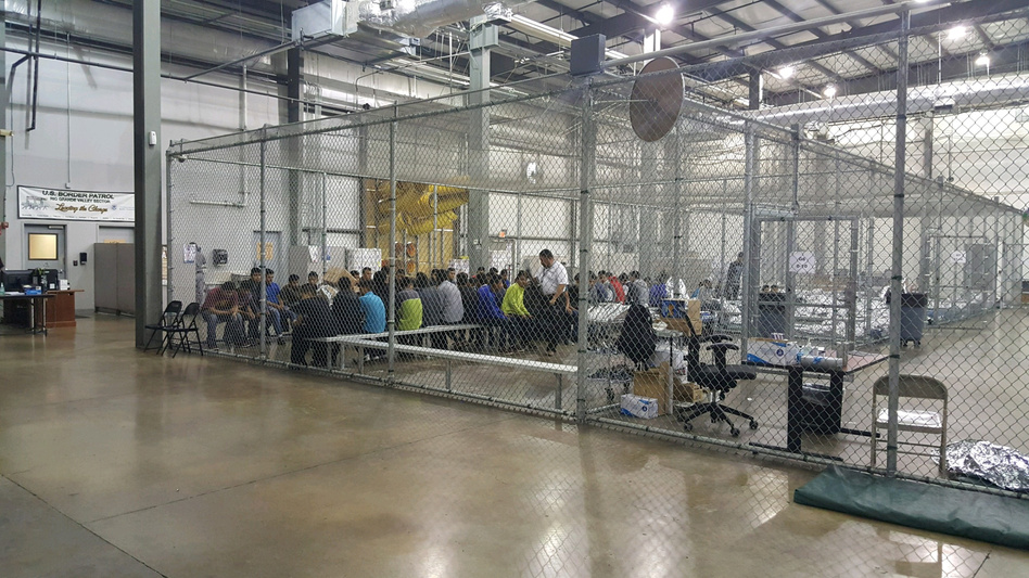 In a handout photo, the inside of a U.S. Customs and Border Protection detention facility shows detainees inside fenced areas at Rio Grande Valley Centralized Processing Center in Rio Grande City, Texas, on June 17. (Courtesy CBP/Handout/via Reuters)