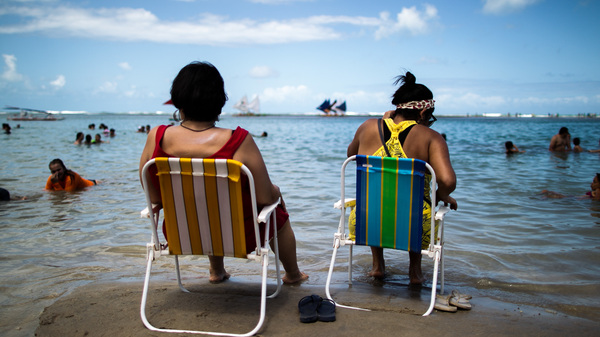 The beaches of Brazil beckon — but travelers need to find out if they